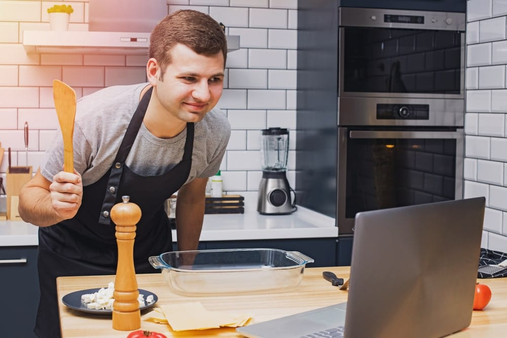 Man taking part in a virtual cooking class