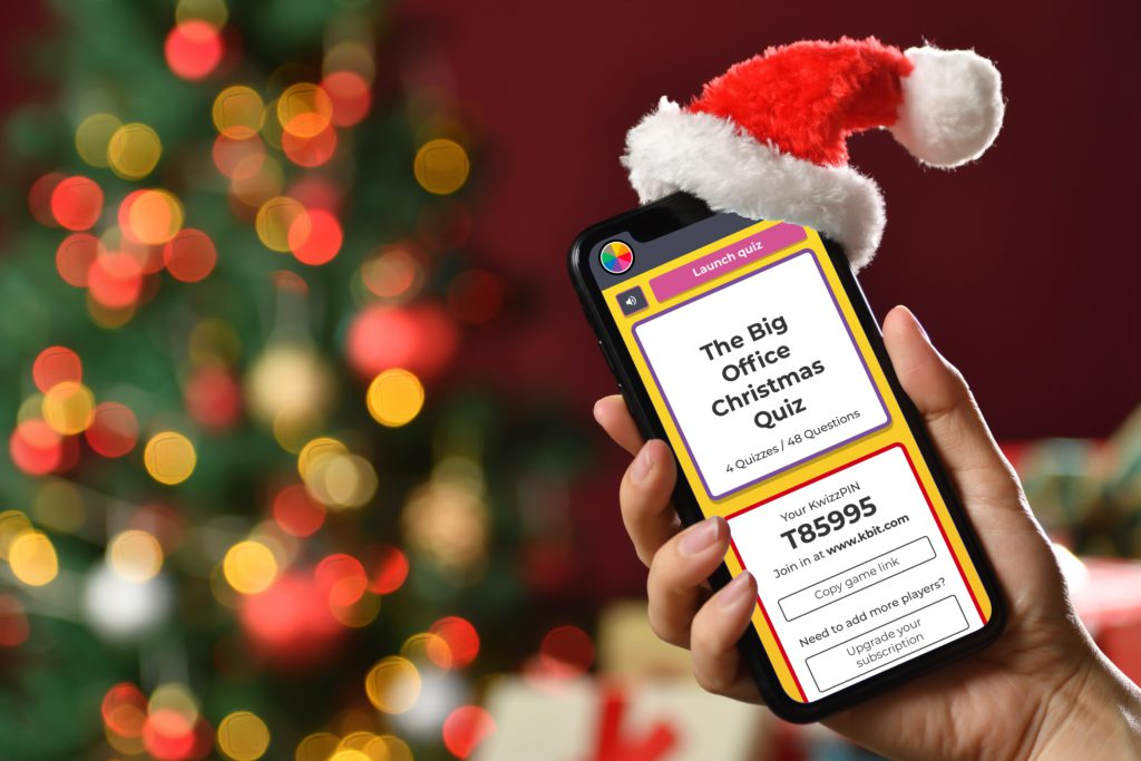 smartphone in Santa hat showing interactive quiz software